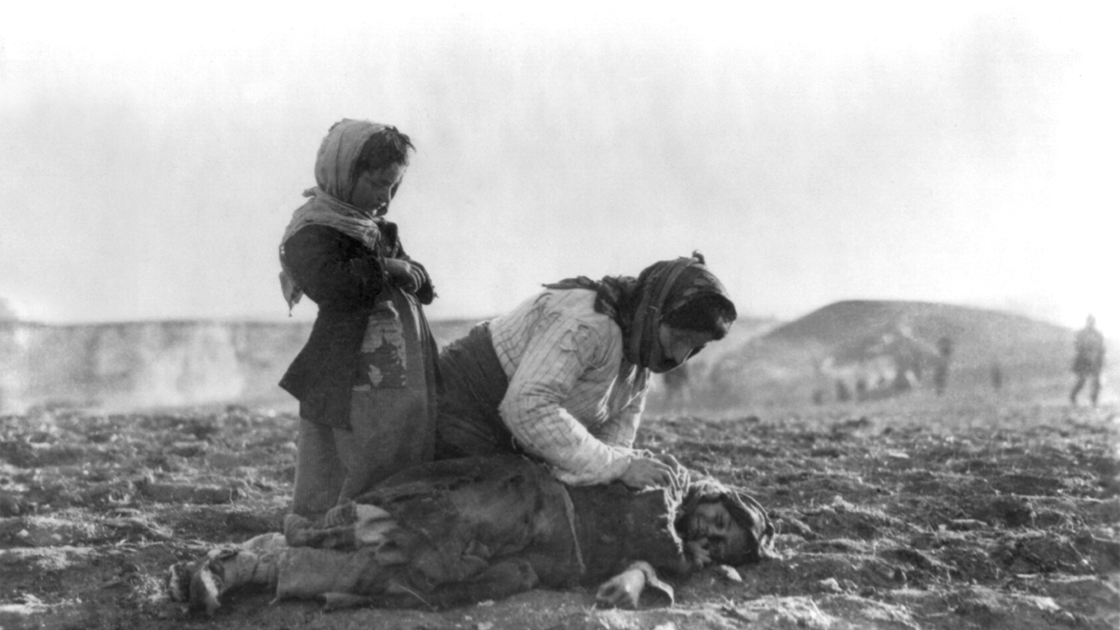 And Armenian woman kneeling over her child, 1915